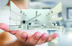 Businessman holding white 3D rendering apartment in his hand