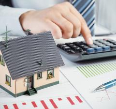 Businessman calculate the cost of building and maintaining home