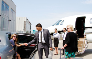 Chauffeur helping lady out of limo