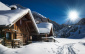 winter ski chalet and cabin in snow mountain  landscape in tyrol austria